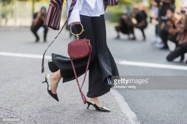 Leonie Hanne wearing stripped jacket flared pants Chloe bag Dior sling backs seen in the streets of Manhattan outside Zimmermann during New York...