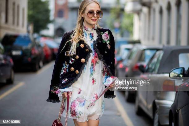 Leonie Hanne wearing white dress leather jacket Dolce Gabbana bag is seen outside Dolce Gabbana during Milan Fashion Week Spring/Summer 2018 on...