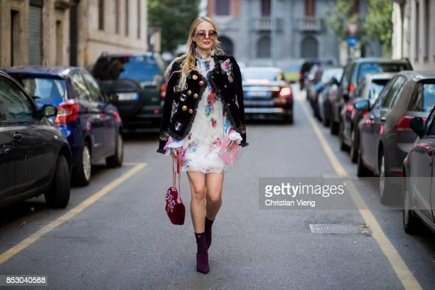 Leonie Hanne wearing white dress leather jacket Dolce Gabbana bag is seen outside Dolce Gabbana during Milan Fashion Week Spring/Summer 2018 on...