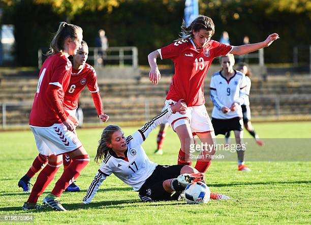Leonie Koester of Germany is challenged by Amalie Littau of Denmark during the International Friendly match between U16 Girl's Germany and U16 Girl's...