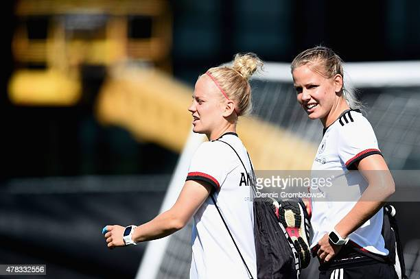 Leonie Maier and Lena Petermann of Germany arrive for a training session at Stade de Montreal on June 24 2015 in Montreal Canada