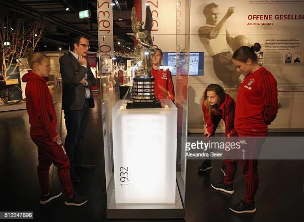 Leonie Maier Melanie Behringer Nora Holstad and Gina Lewandowski of FC Bayern Muenchen visit the FCB Erlebniswelt club museum to handover the 2015...