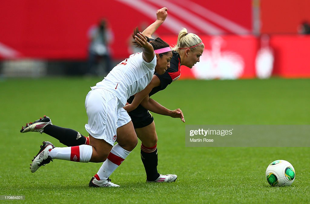Leonie Maier (back) of Germany and Desiree Scott of Canada battle for the ball during the Women's International Friendly match between Germany and Canada at Benteler Arena on June 19, 2013 in Paderborn, Germany.