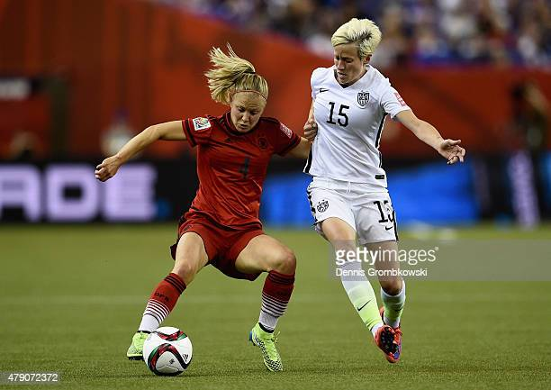 Leonie Maier of Germany and Megan Rapinoe of the United States battle for the ball in the FIFA Women's World Cup 2015 SemiFinal Match at Olympic...