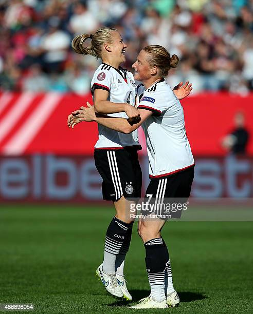 Leonie Maier of Germany celebrates after scoring her team's second goal with Melanie Behringer of Germany during the UEFA Women's Euro 2017 Qualifier...