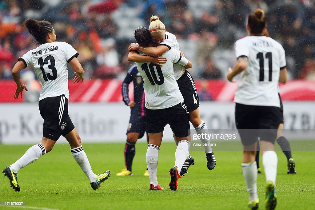 Leonie Maier of Germany celebrates her team's first goal with team mates Celia Okoyino da Mbabi, <a gi-track='captionPersonalityLinkClicked' href=/galleries/search?phrase=Dzsenifer+Marozsan&family=editorial&specificpeople=4261240 ng-click='$event.stopPropagation()'>Dzsenifer Marozsan</a> and <a gi-track='captionPersonalityLinkClicked' href=/galleries/search?phrase=Anja+Mittag&family=editorial&specificpeople=210615 ng-click='$event.stopPropagation()'>Anja Mittag</a> (L-R) during the Women's International Friendly match between Germany and Japan at Allianz Arena on June 29, 2013 in Munich, Germany.