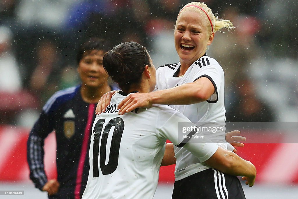 Leonie Maier of Germany celebrates her team's first goal with team mate <a gi-track='captionPersonalityLinkClicked' href=/galleries/search?phrase=Dzsenifer+Marozsan&family=editorial&specificpeople=4261240 ng-click='$event.stopPropagation()'>Dzsenifer Marozsan</a> during the Women's International Friendly match between Germany and Japan at Allianz Arena on June 29, 2013 in Munich, Germany.