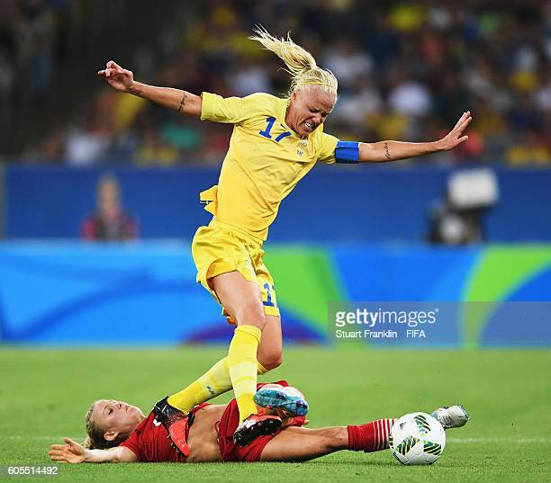 Leonie Maier of Germany is challenged by Caroline Seger of Sweden during the Olympic Women's Football final between Sweden and Germany at Maracana...