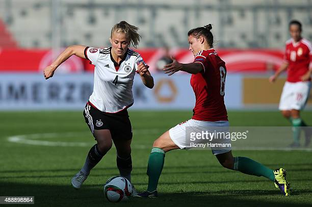 Leonie Maier of Germany vies with Boglarka Szabo of Hungary during the UEFA Women's Euro 2017 Qualifier between Germany and Hungary at Erdgas...