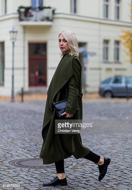 Leonie Markhorst wears a khaki green coat from Ivy Oak black top from Uniqlo black skinny denim jeans from Weekday black shoes from Alexander Wang...