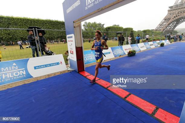 Leonie Periault of France crosses the finish line of the 2017 edition of the Paris triathlon on July 2 2017 in Paris An unprecedented course located...