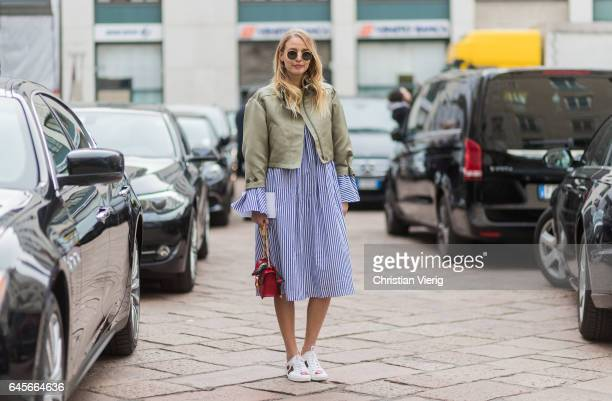 Leonie Sophie Hanne wearing a striped dress cropped bomber jacket Gucci bag and Gucci sneaker outside Salvatore Ferragamo during Milan Fashion Week...