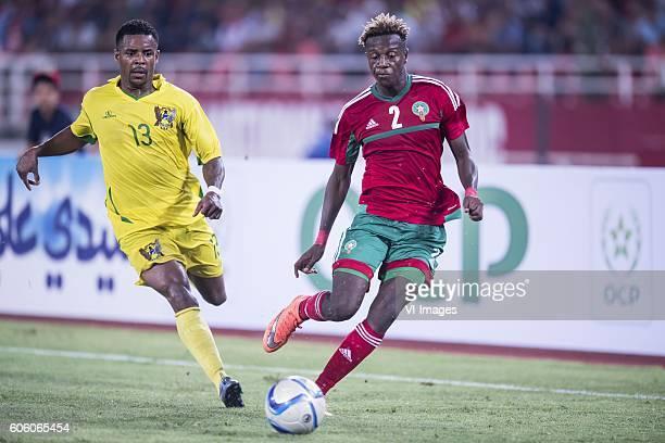 Leonildo Soares G de Ceita of Sao Tome e Principe Hamza Mendyl of Morocco during the Africa Cup of Nations match between Morocco and Sao Tome E...