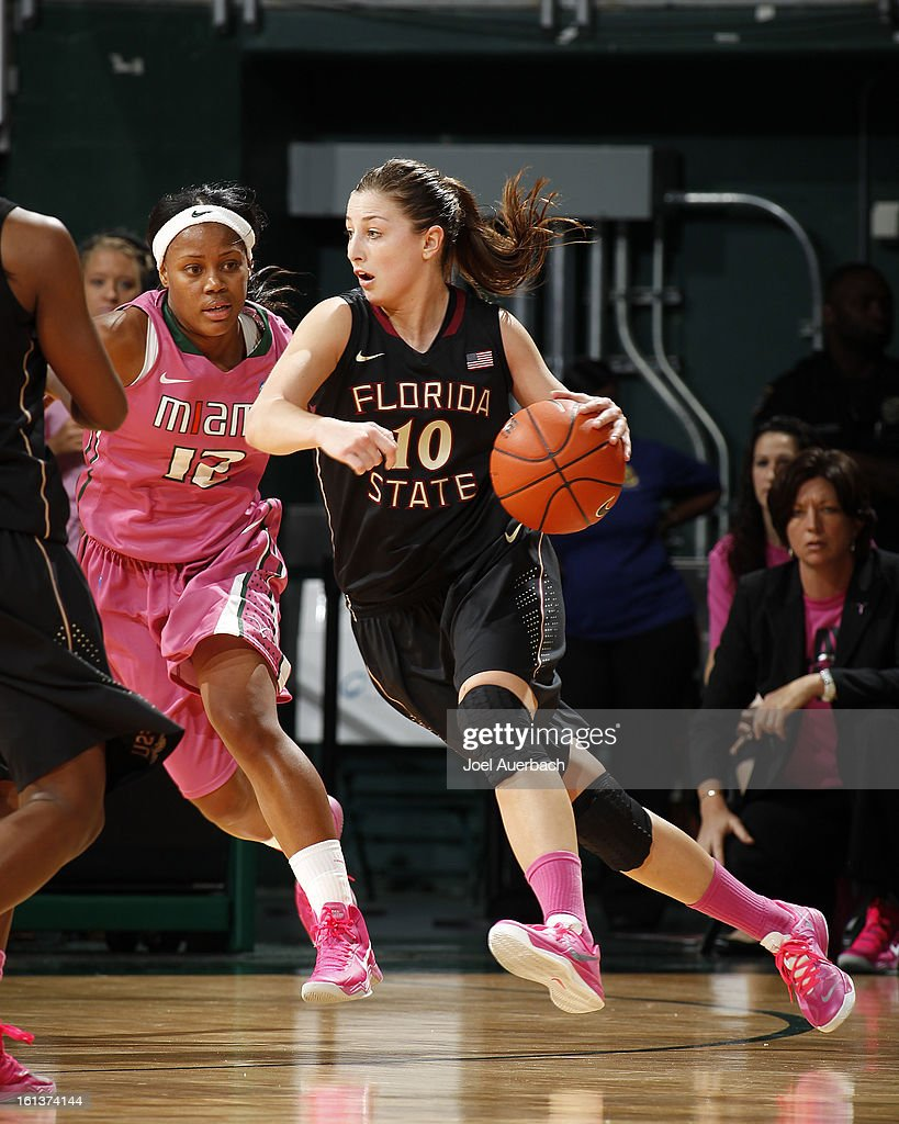 Leonor Rodriguez #10 of the Florida State Seminoles drives to the basket against Krystal Saunders #12 of the Miami Hurricanes on February 10, 2013 at the BankUnited Center in Coral Gables, Florida.