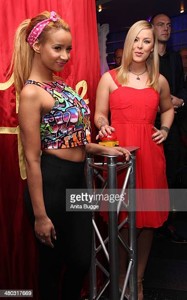 Leonore 'Leo' Bartsch and Gabriella 'Gabby' De Almeida Rinne reveal the Katy Perry wax figure at Madame Tussauds on March 24 2014 in Berlin Germany