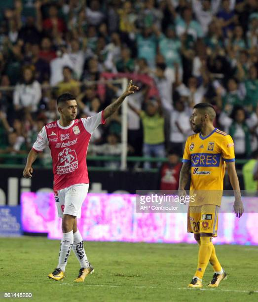 Leon's footballer Elias Hernandez celebrates after scoring against Tigres during their Mexican Apertura tournament match at the Nou Camp stadium in...