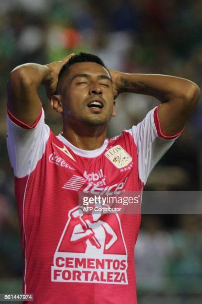 Leon's footballer Elias Hernandez reacts during the Mexican Apertura tournament match against Tigres at the Nou Camp stadium in Leon Mexico on...