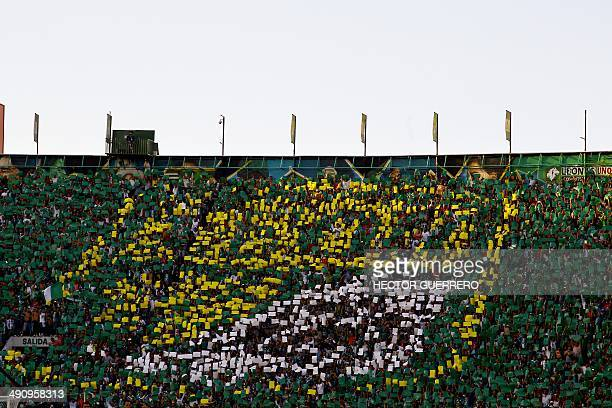 Leon's supporters cheer their team before the start of the Mexican Clausura 2014 firts final match between Leon and Pachuca at Nou Camp stadium on...