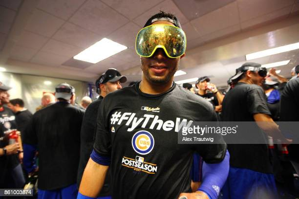 Leonys Martin of the Chicago Cubs celebrates with teammates in the clubhouse after winning Game 5 of the National League Division Series 98 against...