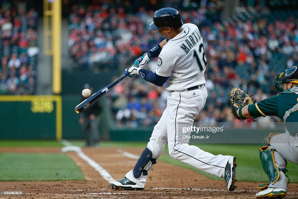 Leonys Martin #12 of the Seattle Mariners hits an RBI single in the third inning against the Oakland Athletics at Safeco Field on May 25, 2016 in Seattle, Washington.