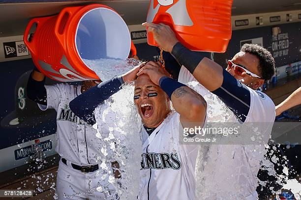 Leonys Martin of the Seattle Mariners is doused by teammates after hitting a walkoff home run in the eleventh inning against the Chicago White Sox at...