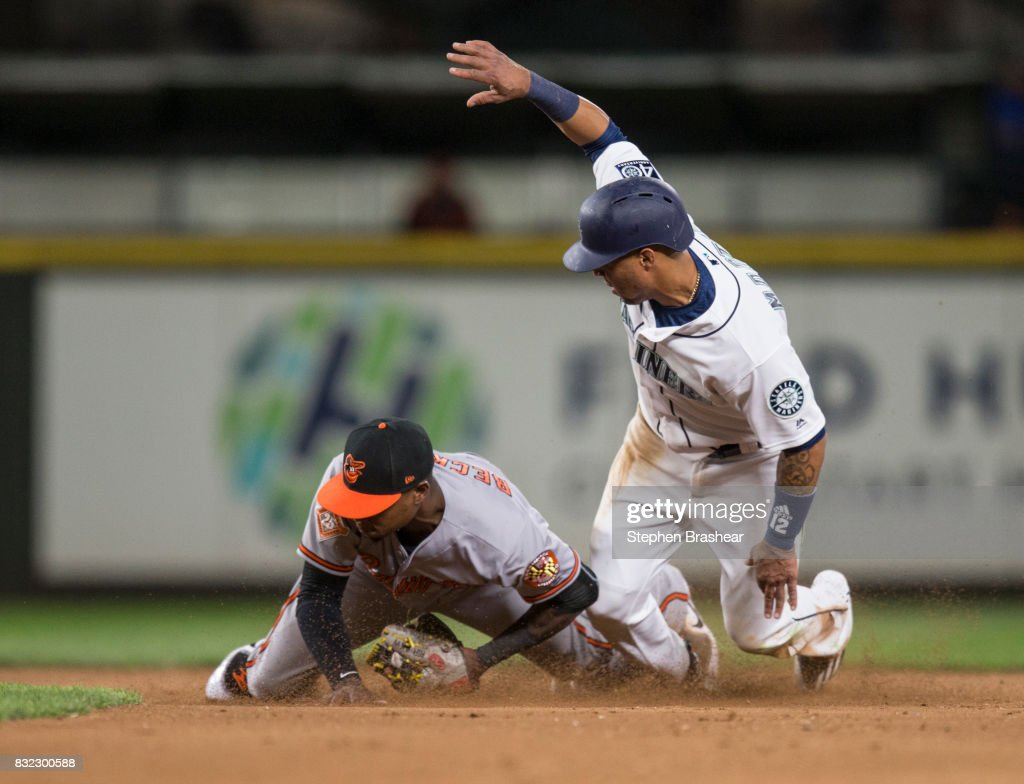 Leonys Martin #12 of the Seattle Mariners jumps up after being tagged out while trying to steal second base by shortstop Tim Beckham #1 of the Baltimore Orioles during the eighth inning of a game at Safeco Field on August 15, 2017 in Seattle, Washington. The Mariners won 3-1.