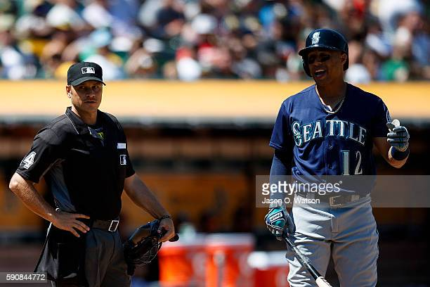 Leonys Martin of the Seattle Mariners reacts in front of umpire Mark Wegner after striking out against the Oakland Athletics during the sixth inning...