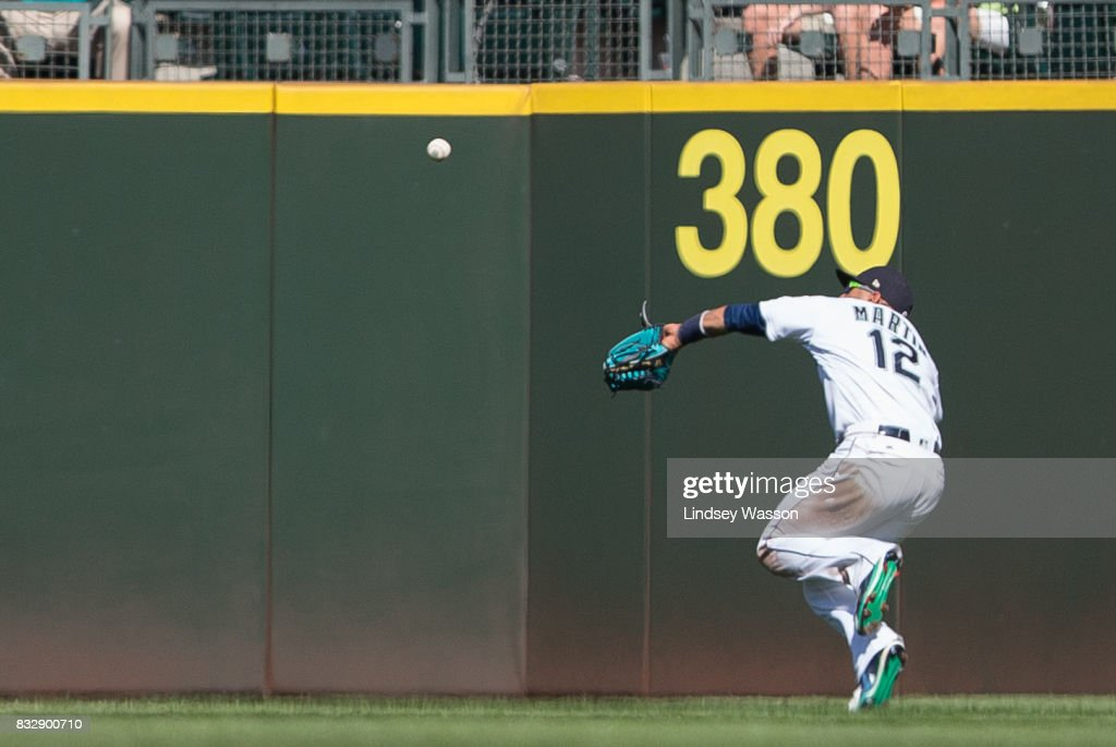 Leonys Martin #12 of the Seattle Mariners runs to grab a long fly ball to right field off the bat of Manny Machado of the Baltimore Orioles, scoring Caleb Joseph in the ninth inning at Safeco Field on August 16, 2017 in Seattle, Washington.