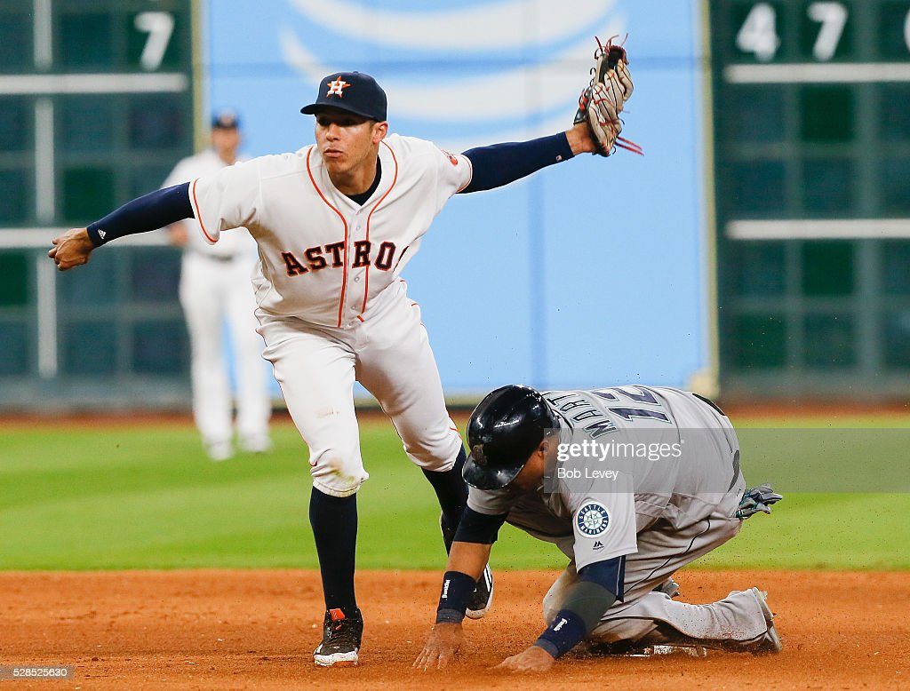 Leonys Martin #12 of the Seattle Mariners steals second base in the fifth inning as <a gi-track='captionPersonalityLinkClicked' href=/galleries/search?phrase=Carlos+Correa+-+Jogador+de+basebol&family=editorial&specificpeople=11452157 ng-click='$event.stopPropagation()'>Carlos Correa</a> #1 of the Houston Astros applies the tag on May 05, 2016 in Houston, Texas.