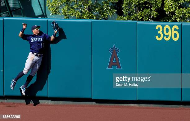 Leonys Martin of the Seattle Mariners watches a home run leave the park hit by Albert Pujols of the Los Angeles Angels of Anaheim during the ninth...