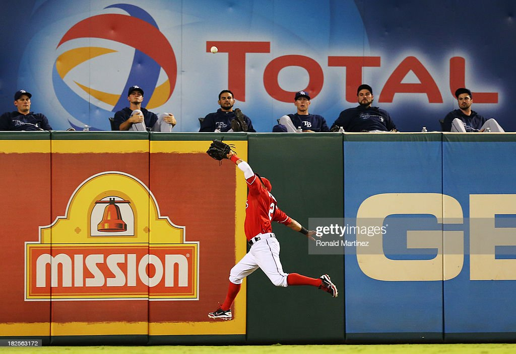 Leonys Martin #2 of the Texas Rangers catches a fly ball by by <a gi-track='captionPersonalityLinkClicked' href=/galleries/search?phrase=James+Loney&family=editorial&specificpeople=636293 ng-click='$event.stopPropagation()'>James Loney</a> #21 of the Tampa Bay Rays in the fourth inning during the American League Wild Card tiebreaker game at Rangers Ballpark in Arlington on September 30, 2013 in Arlington, Texas.