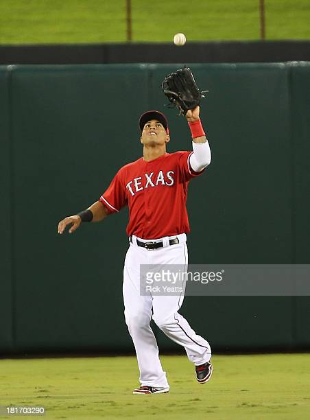 Leonys Martin of the Texas Rangers catches a fly ball to center hit by Brandon Laird of the Houston Astros in the second inning at Rangers Ballpark...