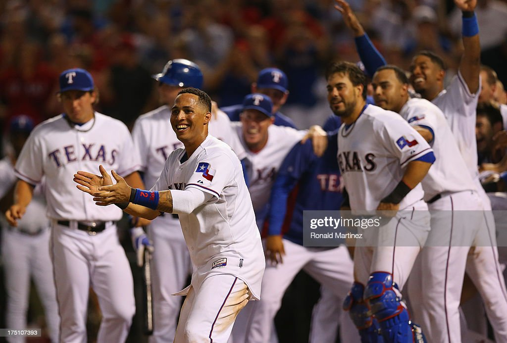 Leonys Martin #2 of the Texas Rangers celebrates a walk off homerun by Adrian Beltre against the Los Angeles Angels at Rangers Ballpark in Arlington on July 31, 2013 in Arlington, Texas.