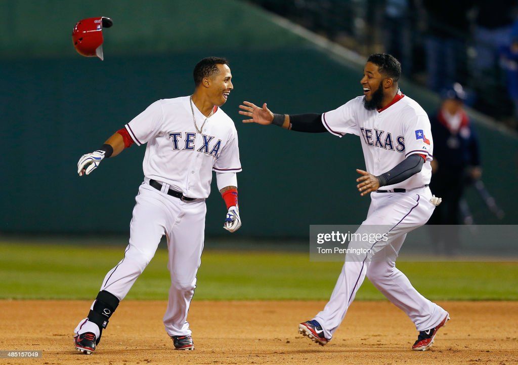 Leonys Martin of the Texas Rangers celebrates with Elvis Andrus of the Texas Rangers after Martin hit a walk off RBI single in the bottom of the...