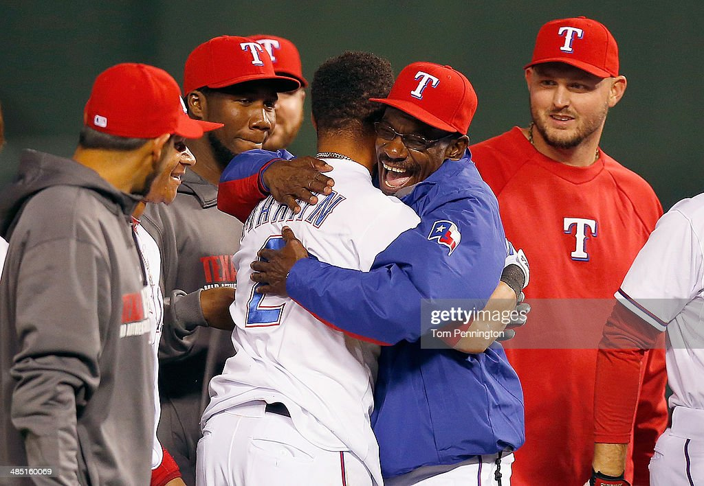 Leonys Martin #2 of the Texas Rangers celebrates with manager <a gi-track='captionPersonalityLinkClicked' href=/galleries/search?phrase=Ron+Washington&family=editorial&specificpeople=225012 ng-click='$event.stopPropagation()'>Ron Washington</a> #38 of the Texas Rangers after hitting a walk off RBI single in the bottom of the ninth inning against the Seattle Mariners at Globe Life Park in Arlington on April 16, 2014 in Arlington, Texas.