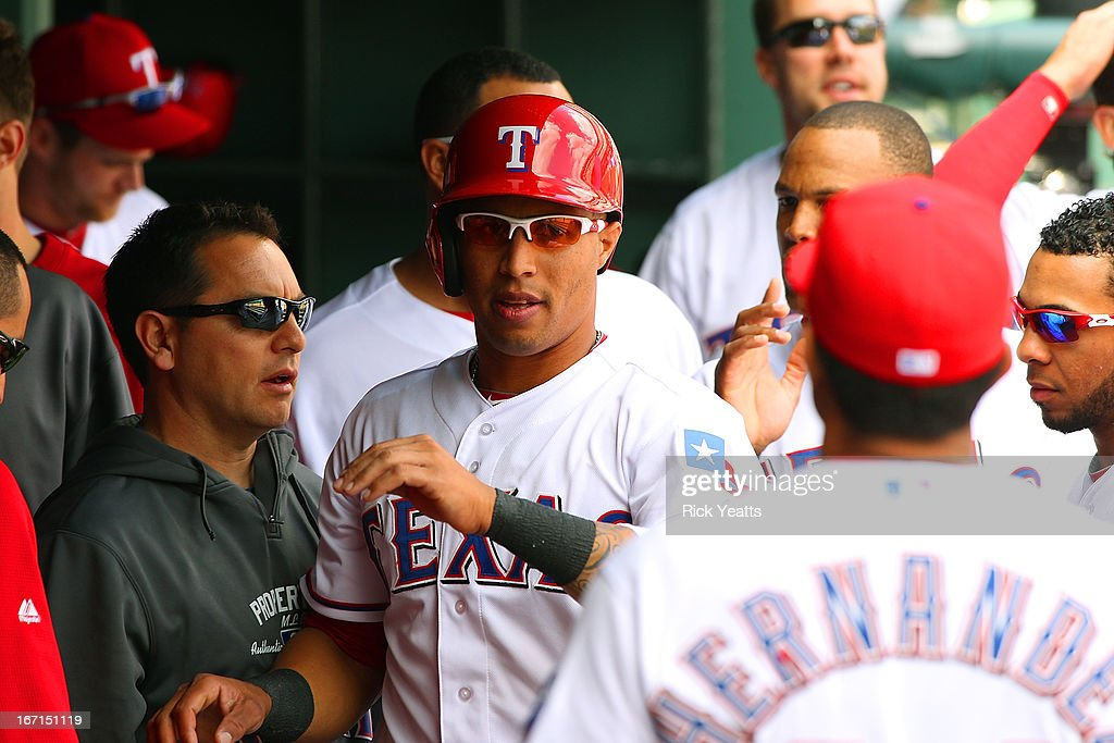 Leonys Martin #2 of the Texas Rangers is congratulated by his teammates for scoring on a hit against the Seattle Mariners at Rangers Ballpark in Arlington on April 21, 2013 in Arlington, Texas.