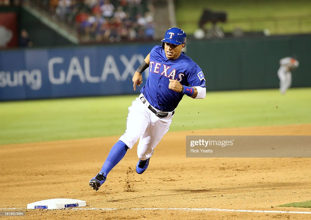 Leonys Martin #2 of the Texas Rangers rounds third to score on a single hit by Ian Kinsler against the Houston Astros at Rangers Ballpark in Arlington on September 25, 2013 in Arlington, Texas.