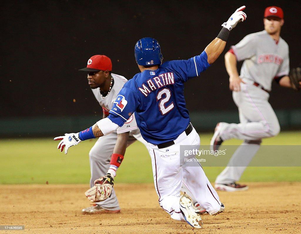 Leonys Martin #2 of the Texas Rangers steals second base against Brandon Phillips #4 of the Cincinnati Reds at Rangers Ballpark in Arlington on June 28, 2013 in Arlington, Texas.
