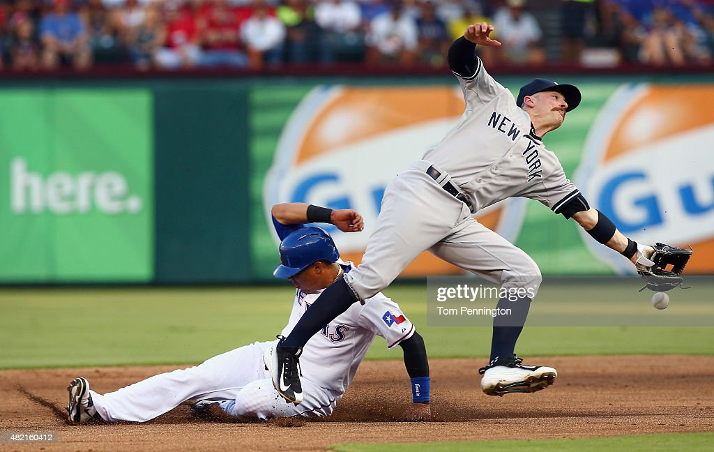 Leonys Martin #2 of the Texas Rangers steals second base against <a gi-track='captionPersonalityLinkClicked' href=/galleries/search?phrase=Brendan+Ryan&family=editorial&specificpeople=835643 ng-click='$event.stopPropagation()'>Brendan Ryan</a> #17 of the New York Yankees in the bottom of the second inning at Globe Life Park in Arlington on July 27, 2015 in Arlington, Texas.