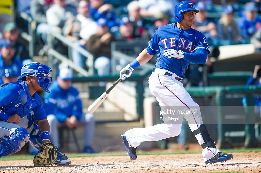Leonys Martin #2 of the Texas Rangers triples in the second inning during a spring training game against the Kansas City Royals at Surprise Stadium on February 24, 2013 in Surprise, Arizona.