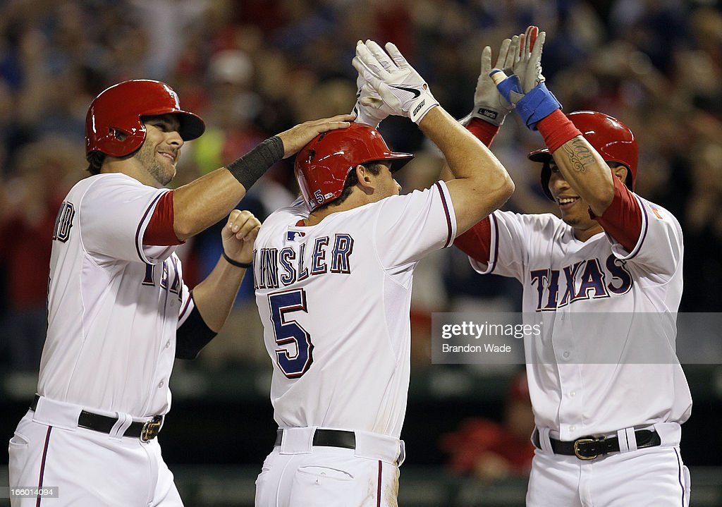 Leonys Martin #2, right, and <a gi-track='captionPersonalityLinkClicked' href=/galleries/search?phrase=Mitch+Moreland&family=editorial&specificpeople=6824046 ng-click='$event.stopPropagation()'>Mitch Moreland</a> #18, left, congratulate teammate <a gi-track='captionPersonalityLinkClicked' href=/galleries/search?phrase=Ian+Kinsler&family=editorial&specificpeople=538104 ng-click='$event.stopPropagation()'>Ian Kinsler</a> #5 of the Texas Rangers after he hit a three-run home run during the sixth inning of a baseball game against the Los Angeles Angels of Anaheim at Rangers Ballpark in Arlington on April 7, 2013 in Arlington, Texas.