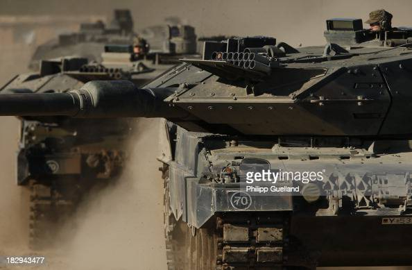 Leopard 2 A6 are seen during the annual military exercises held for the media at the Bergen military training grounds on October 2 2013 near Munster...