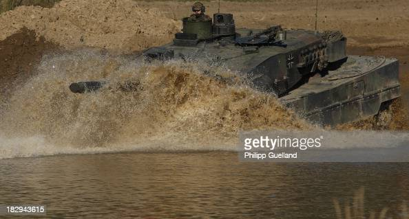 Leopard 2 A6 combat tank crosses a pond during the annual military exercises held for the media at the Bergen military training grounds on October 2...
