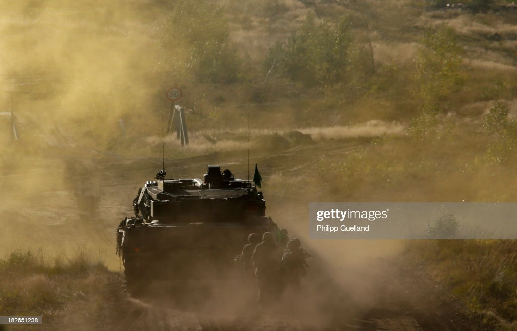 A Leopard 2 A6 combat tank is silhouetted during the annual military exercises held for the media at the Bergen military training grounds on October 2, 2013 near Munster, Germany. The Bundeswehr is transitioning to a professional army as Germany recently ended mandatory military service.