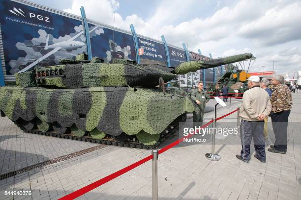 A Leopard 2 tank is seen covered in a camouflage net is seen at the 25th International Defence Industry Exhibition on 8 September 2017