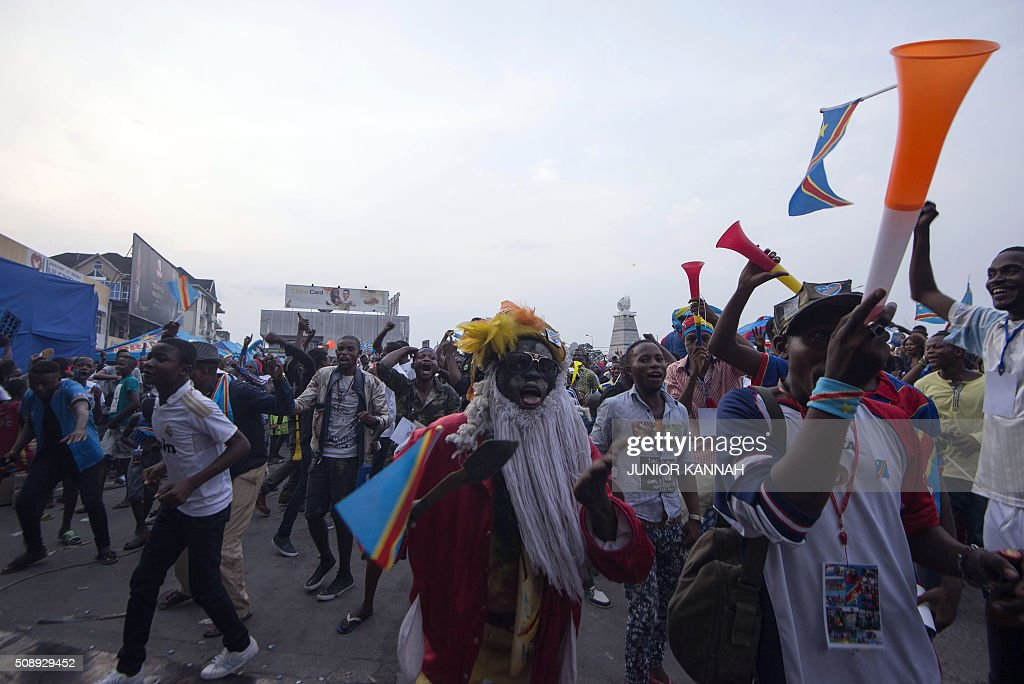 Leopards' supporters celebrate after DR Congo's team scored a goal during the African Nations Championship (CHAN) football final match between DR Congo's Leopards and Mali's Eagles on February 7, 2016 in Lingala. / AFP / JUNIOR KANNAH