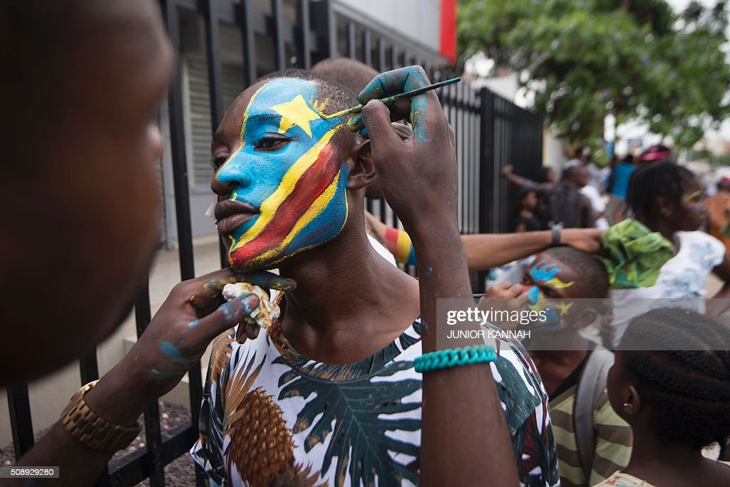 Leopards' supporters have their faces painted for the African Nations Championship (CHAN) football final between DR Congo's Leopards and Mali's Eagles on February 7, 2016 in Lingala. / AFP / JUNIOR KANNAH