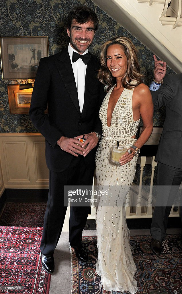 Leopoldo Zambeletti (L) and Tara Bernerd attend the launch of 'The Eighties: One Day, One Decade' by GQ editor Dylan Jones at Mark's Club on June 6, 2013 in London, England.
