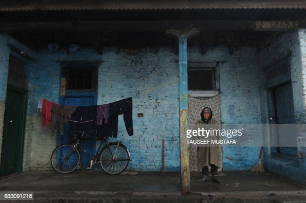 TOPSHOT A leprosy patient stands outside a structure at the leprosy hospital in downtown Srinagar on January 30 2017 World Leprosy Day is observed on...