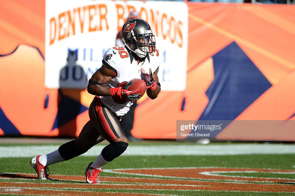 LeQuan Lewis #30 of the Tampa Bay Buccaneers returns a kick off during the game against the Denver Broncos at Sports Authority Field at Mile High on December 2, 2012 in Denver, Colorado.